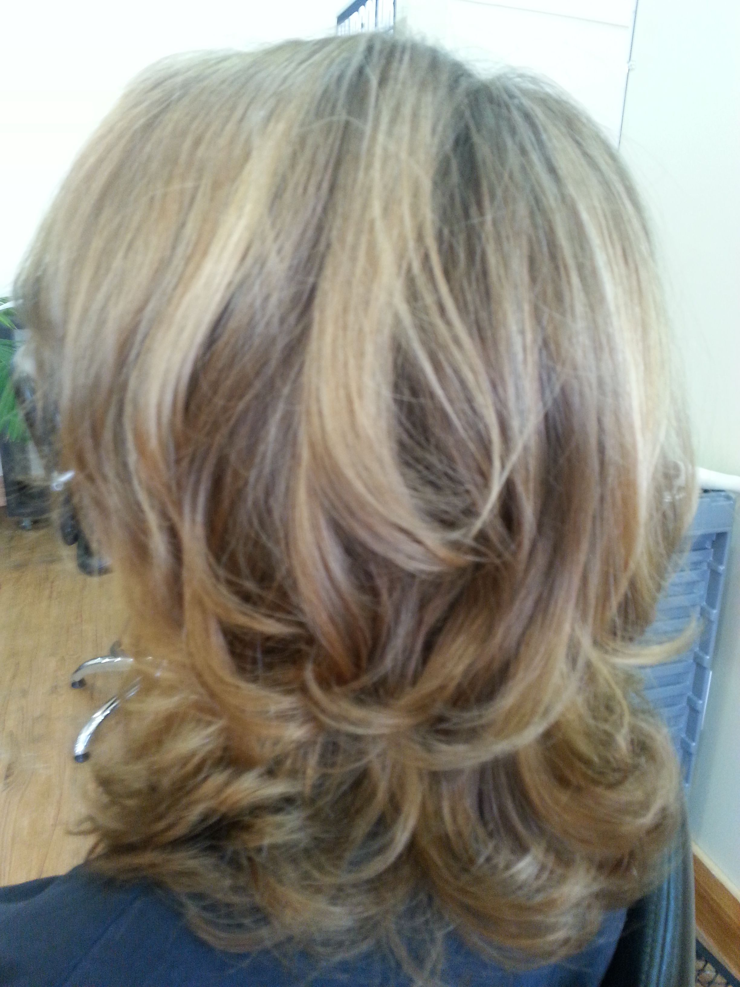 Dark blonde with highlights on medium long layered hair t and