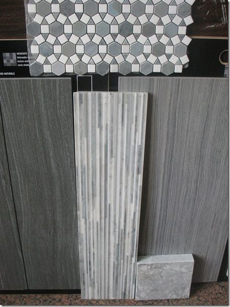 Love this combo of tiles for the bathroom!