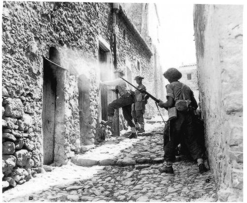 Soldiers of Charlie Company—6th Battalion of the Royal Inniskilling Fusiliers, 38th Irish Infantry Brigade—house clearing in the town of Centuripe, east of Sicily during Operation Husky, 2 August 1943
