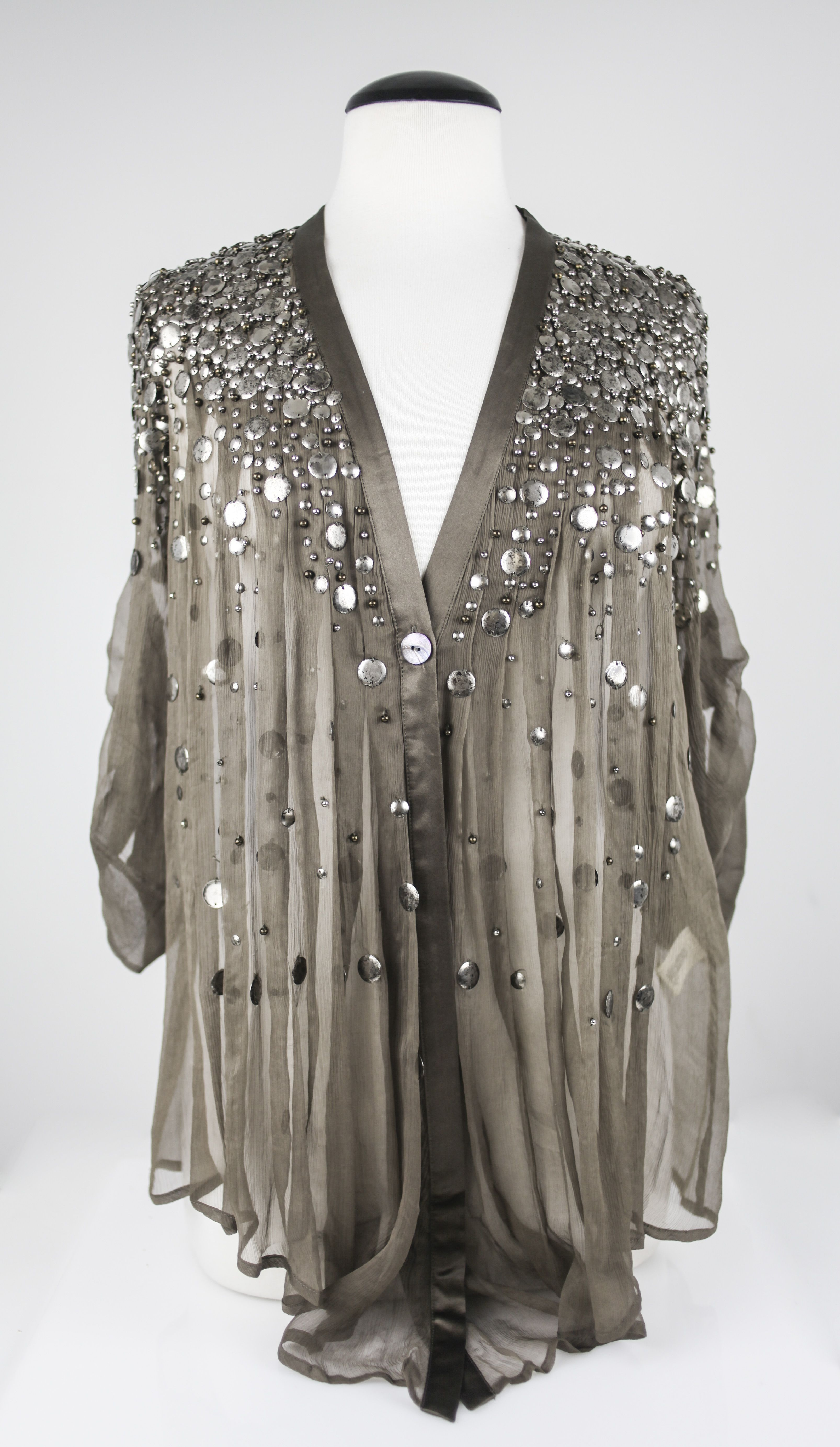 bec147e3cf4e9 ELIZABETH AND JAMES  Off White Sequinned Tokyo Top. Olive sheer open blouse  with heavy silver disc embellishment to shoulders and front.