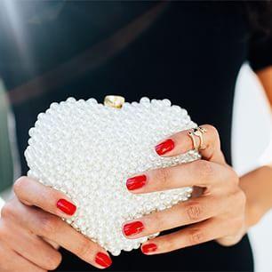 heart pearl clutch