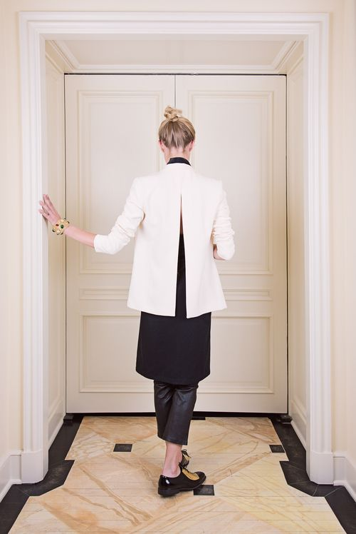 THE DRESS in Black with no belt and layered with black leather leggings and open-back winter-white blazer available at Totokaelo.