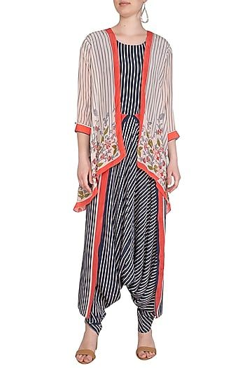 526adee9a7 Featuring an indigo blue overlay dhoti style jumpsuit in poly crepe base  with striped print and