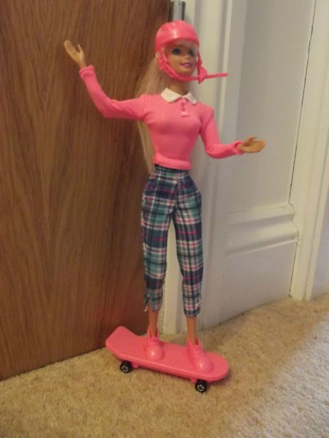 90's - Barbie with skateboard - Mattel - She had a dog that actually walked and would pull her on the skateboard