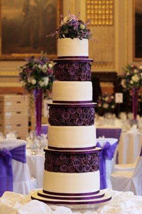 Awesome purple & off white tower cake.