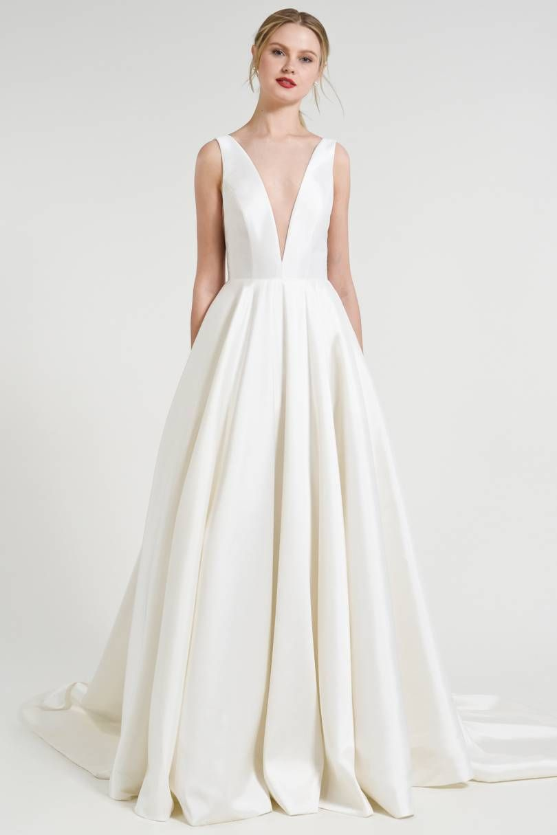 20 Simple And Elegant Wedding Dresses You Can Buy Right Now Plain Wedding Dress Minimalist Gown Minimalist Wedding Dresses [ 1215 x 810 Pixel ]
