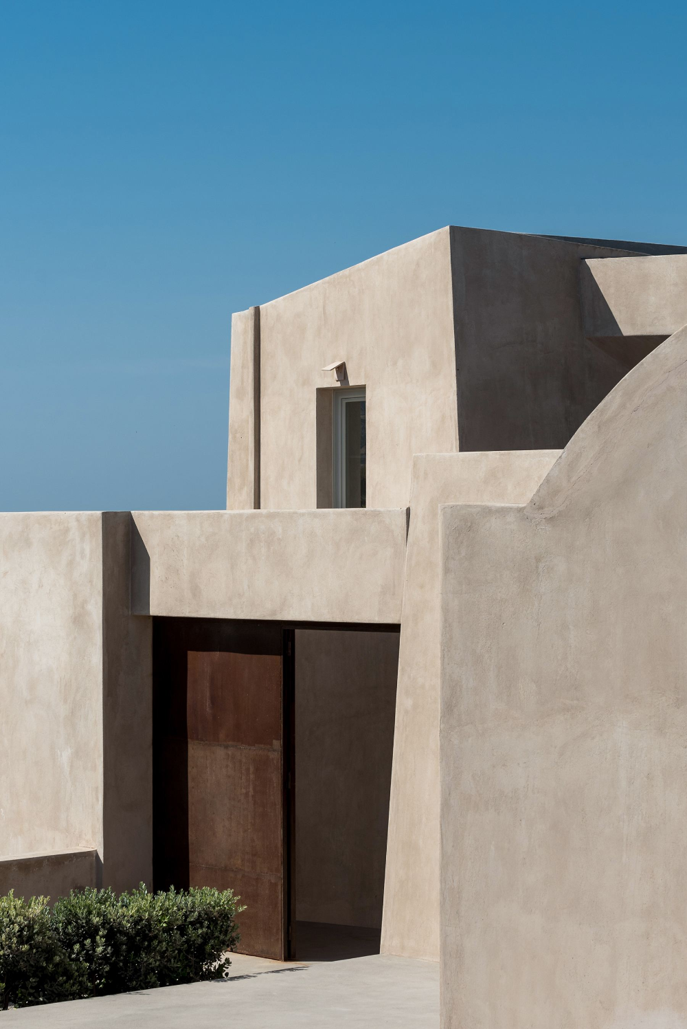 A Monolithic Hilltop Residence In Santorini Is Rooted To Its Historic Location