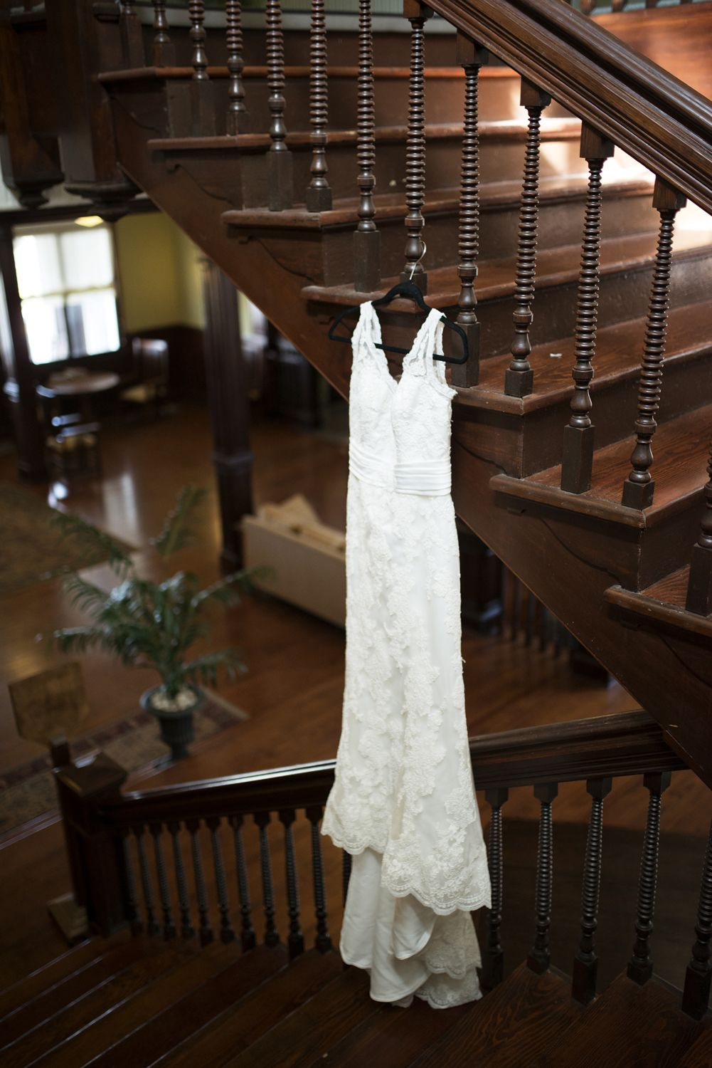 Lace wedding dress on a beautiful wooden staricase