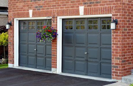 Brick House With Black Garage Doors Close Up Of Black