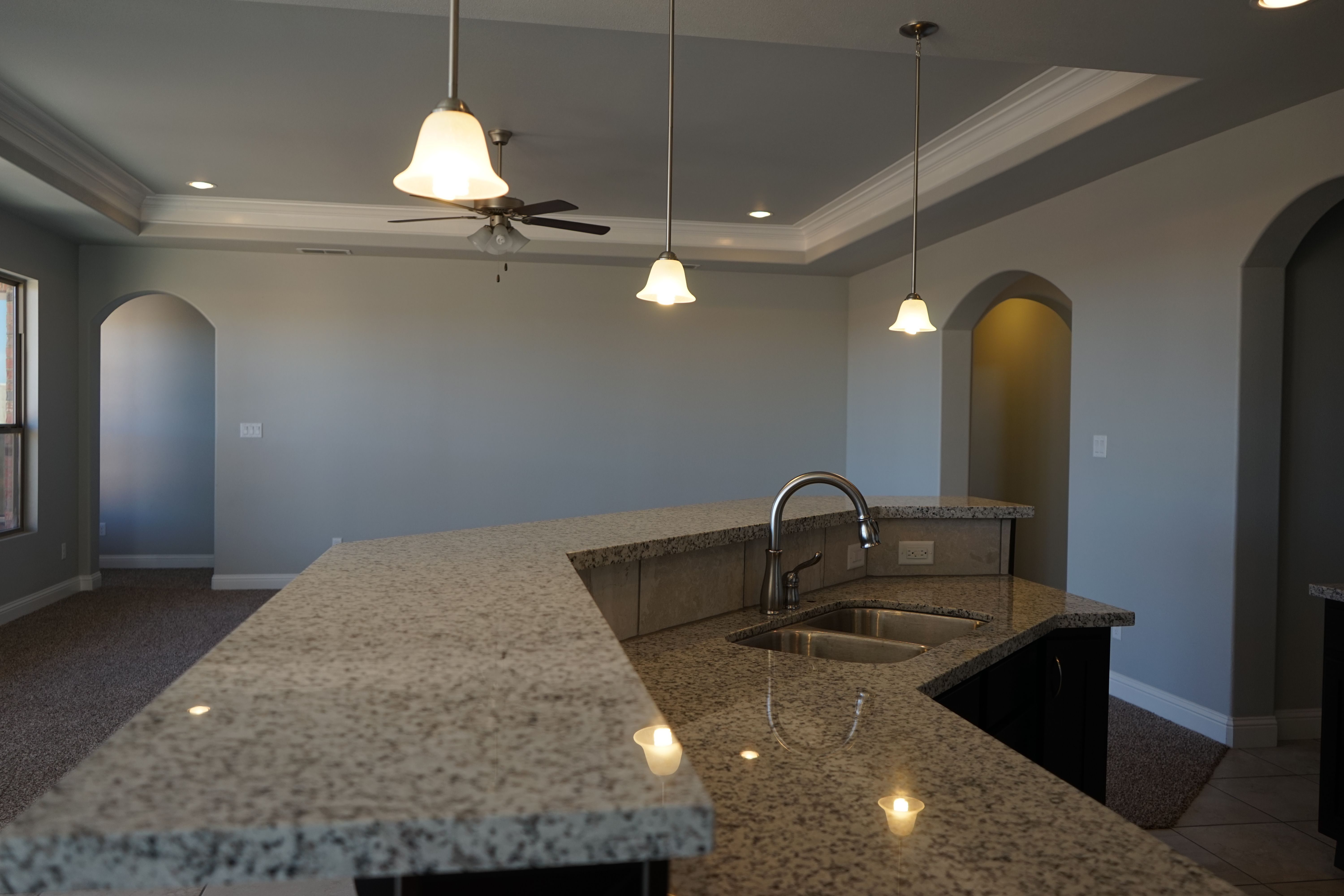 Stain Cabinets And White Pearl Granite