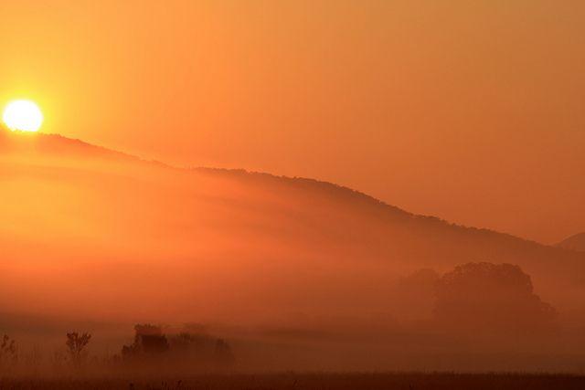 Sun rises over a Great Smoky mountain peak, via Flickr.