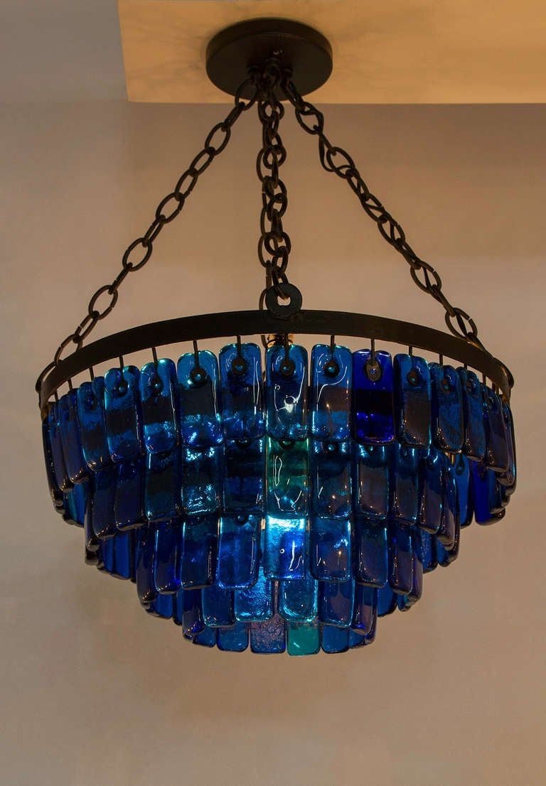 Cascading Heavy Glass Chandelier Mounted On Iron Frame With