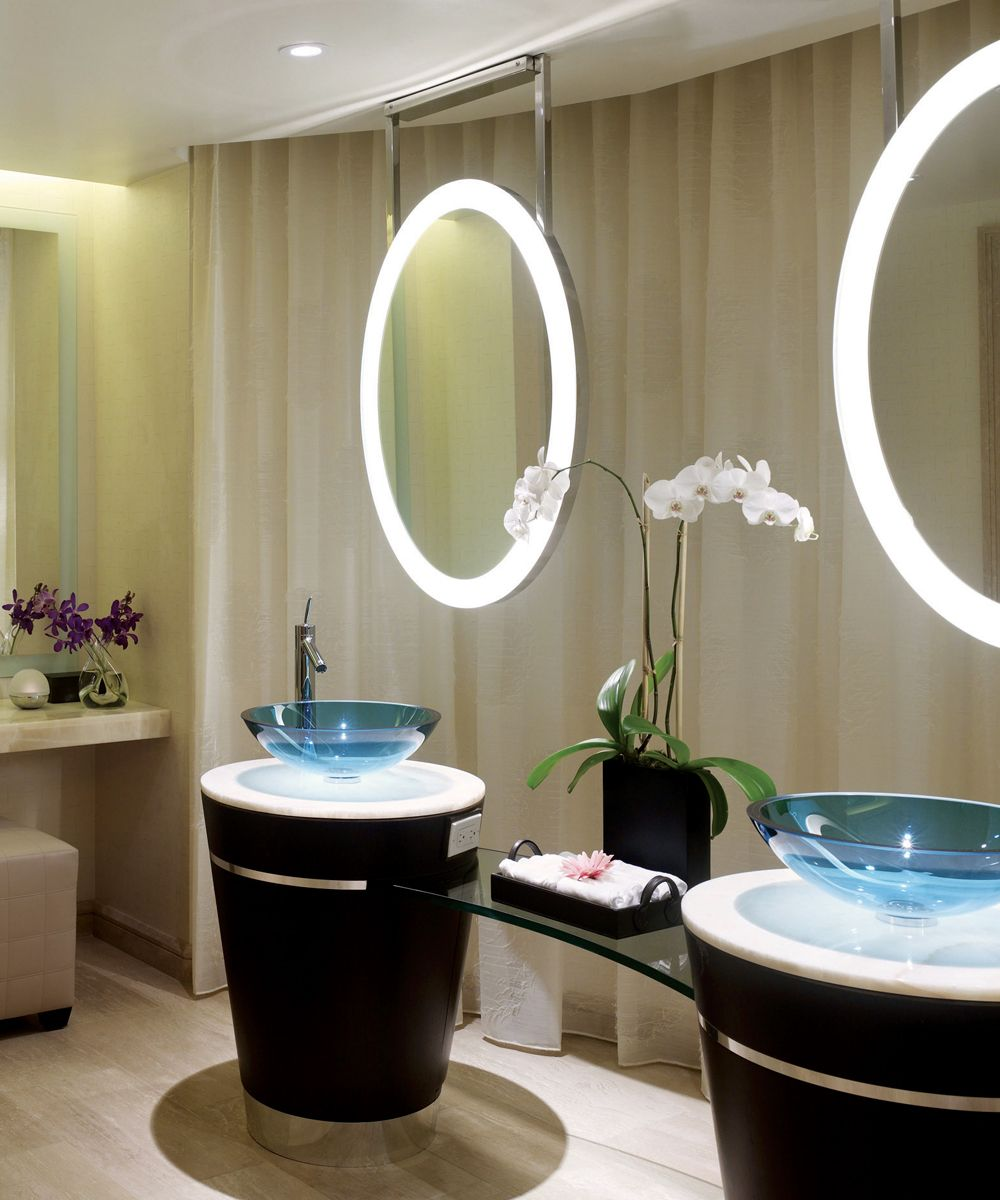 The Elite™ Lighted Mirror is oval shaped with a border of