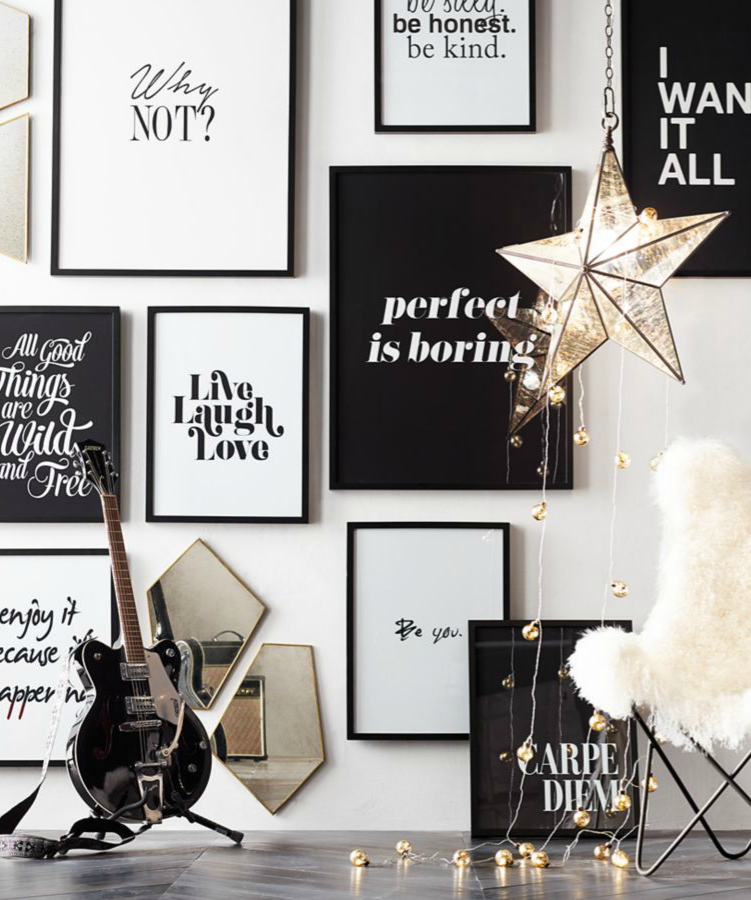 A wall of blackandwhite quote art makes a bold—and