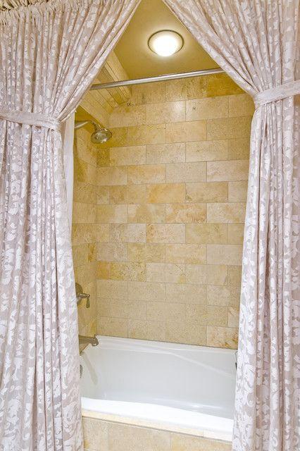 Mediterranean Bathroom Details With Travertine Tile Shower Backsplash And Luxury Curtains Metal Headboard