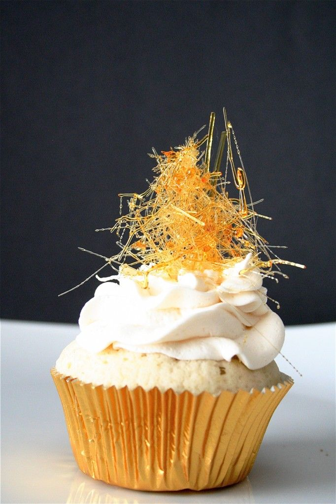 champagne cupcakes with champagne buttercream and spun sugar on top!