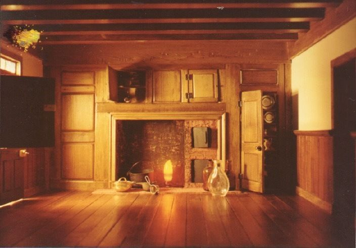 This Georgian Colonial dollhouse is a hand-made museum quality miniature. Built of wood, this model is scaled an inch to the foot and measures 48 inches long, 35 inches deep, and 47 inches to the chimney tops. Both the front and back walls swing open on hinges to reveal the classic floor plan of an eighteenth century Georgian Colonial home