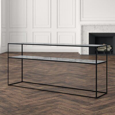 Notre Monde This table was exquisitely made from the finest materials that are sure to make a lasting impression. Color: Charcoal