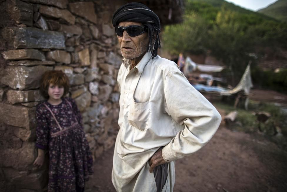 A man whose family moved to Islamabad from Pakistan's Khyber-Pakhtunkhwa province to look for work stands outside his house on the outskirts of Islamabad October 30, 2014. REUTERS/Zohra Bensemra