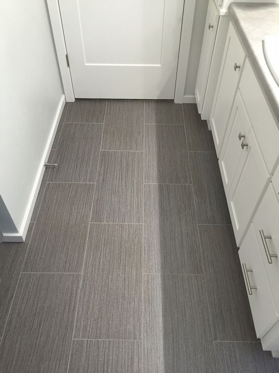 Love The Flooring In This Bathroom Beautiful Color And Love The Tile Look Vinyl Flooring Bathroom Luxury Vinyl Flooring Bathroom Vinyl Tile Flooring Bathroom