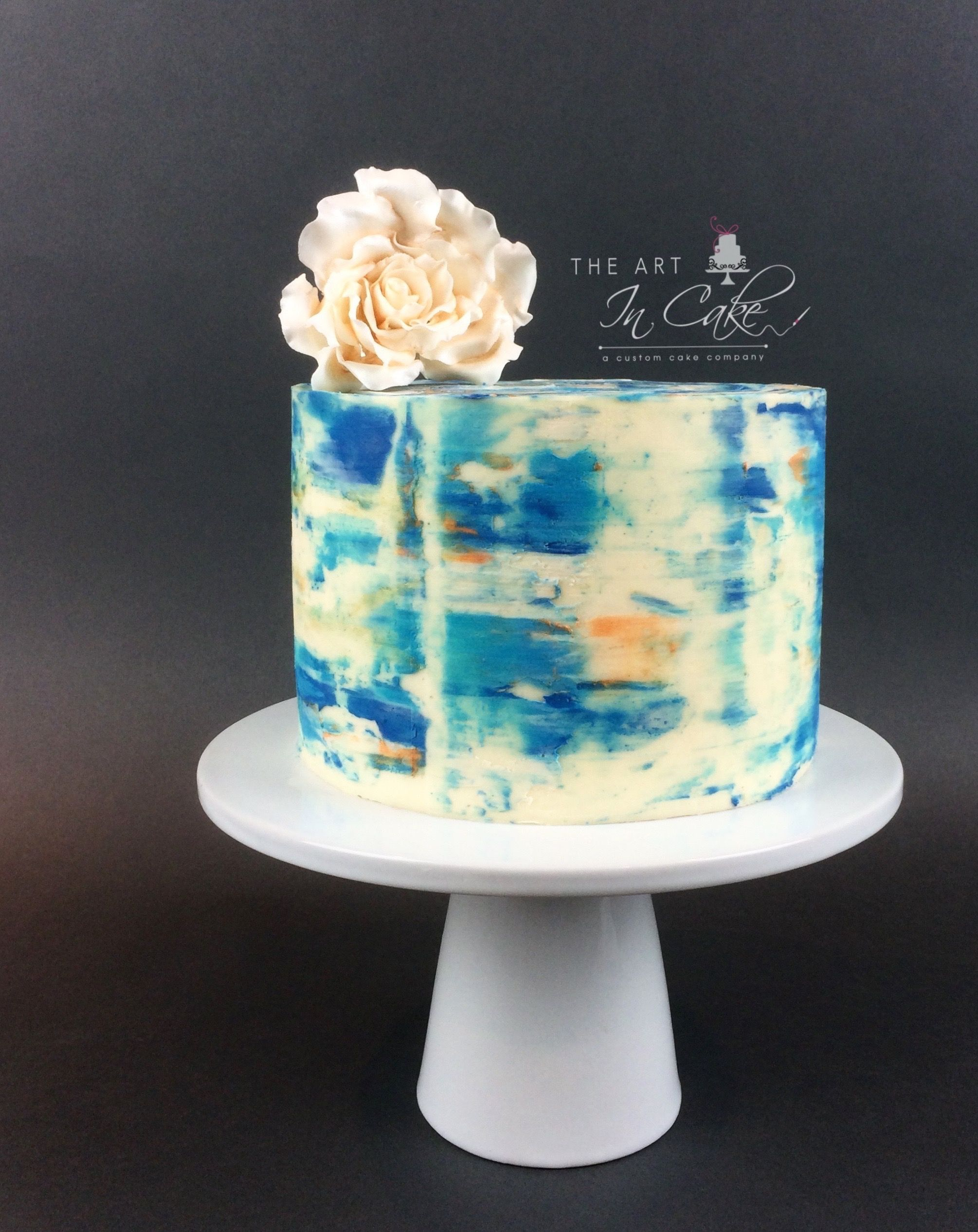 Single Tier Abstract Watercolor Cake In Buttercream In Shades Of