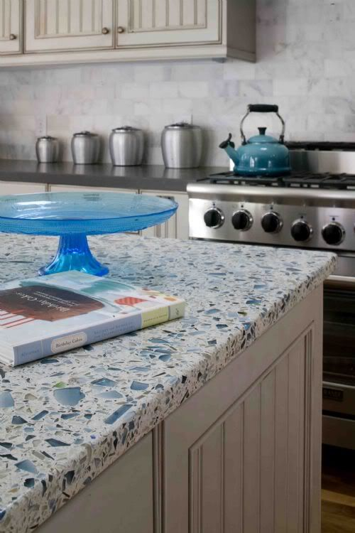Grey perimeter counters, marble backsplash, recycled glass island countertop