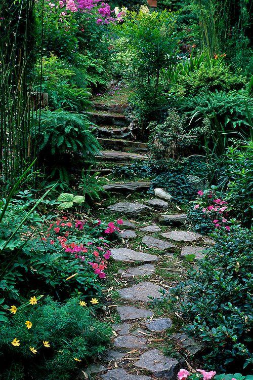 Path Of Stepping Stones Through Garden In Spring