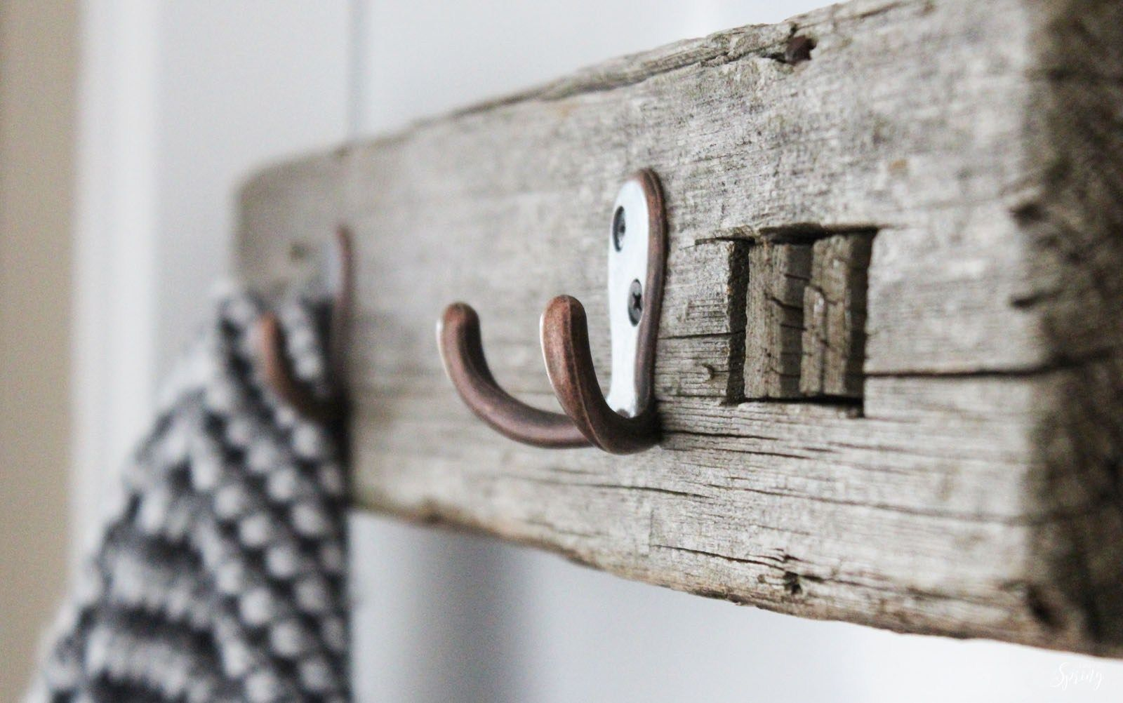 A simple DIY upcycle project using an old plank of wood to create a rustic farmhouse style coat rack.