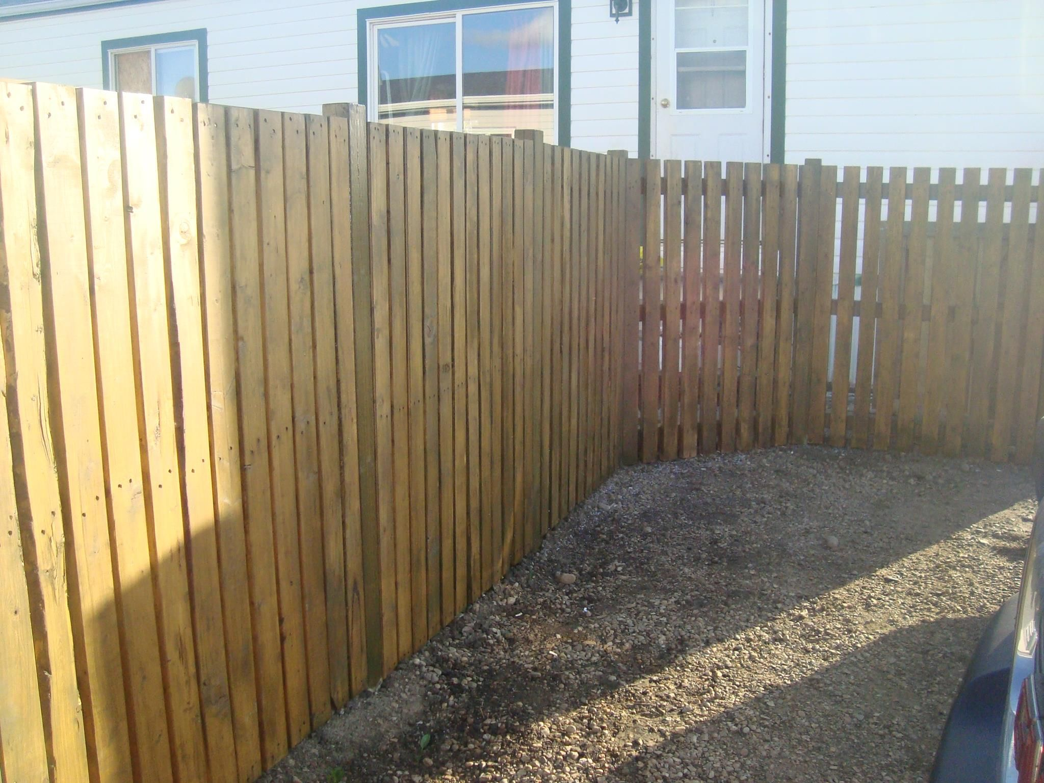Our 200 Pallet Fence All That Was Paid For Was Screws Fence Posts Cement Auger Rental Stain Looks Great After It S Been S Pallet Fence Fence Fence Post