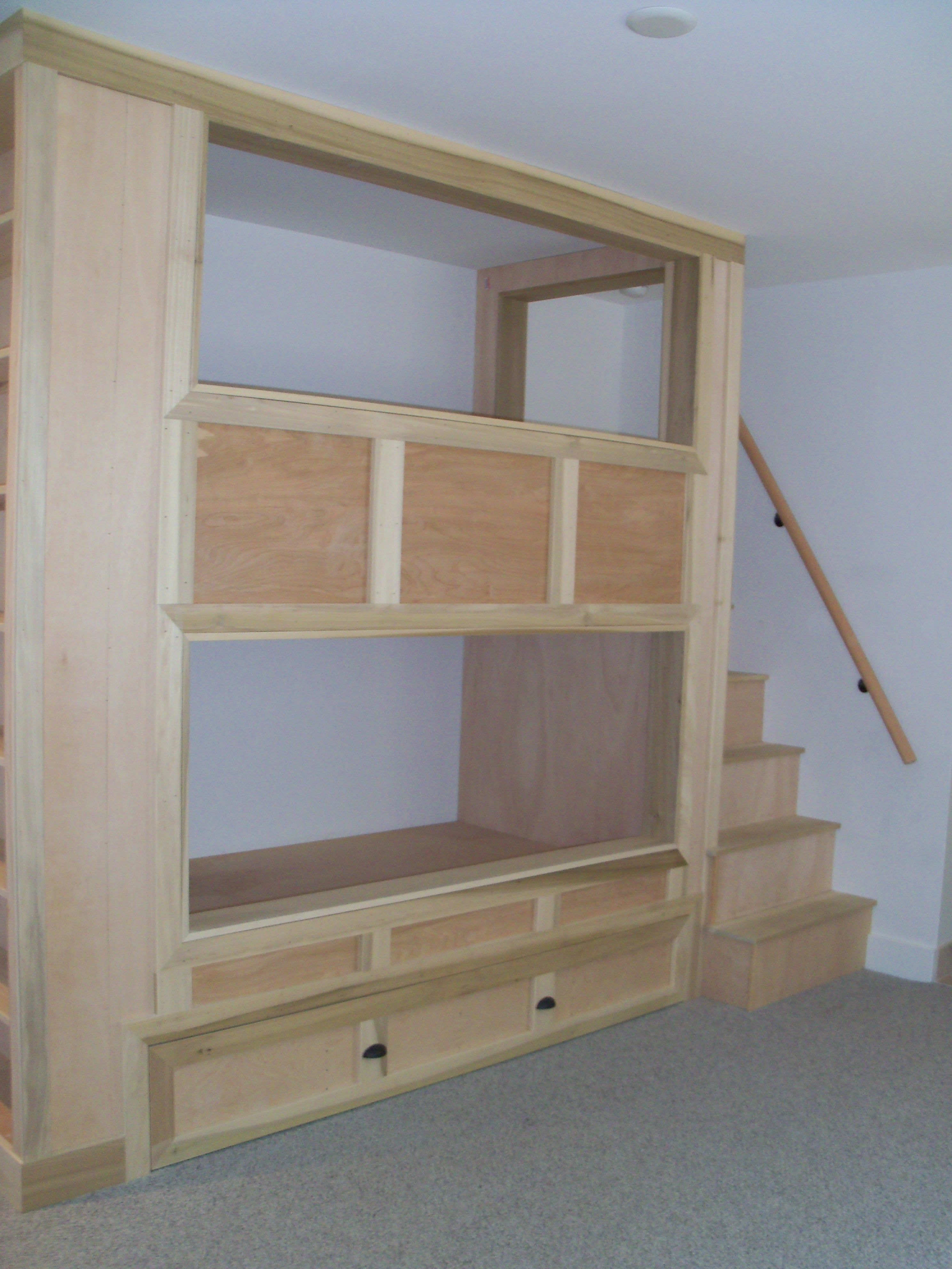 Built in bunk beds with bookshelves and pull out trundle bed 2