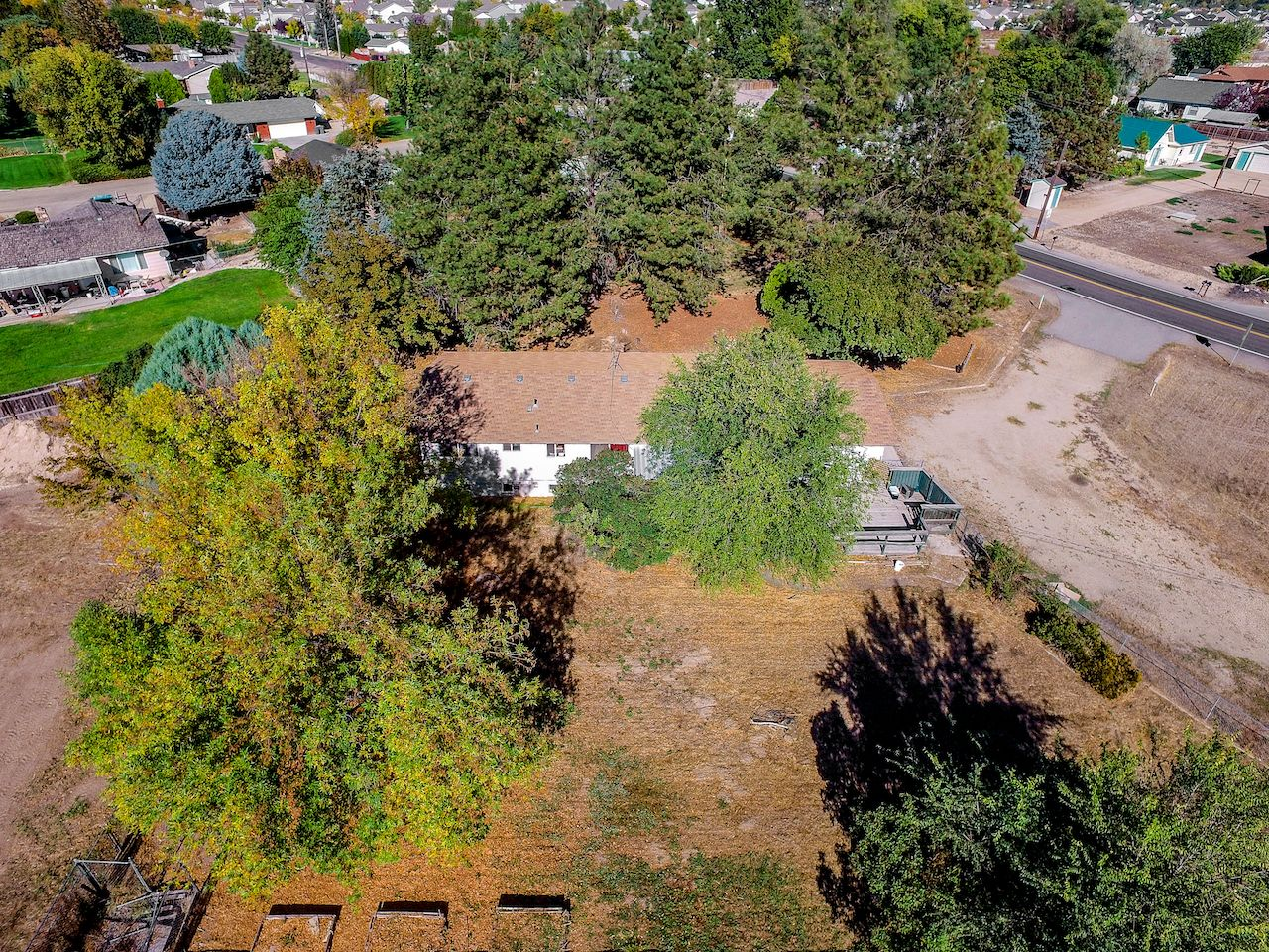 Garden bed with trees  Great lot on  of an acre with two entry turn around driveway and