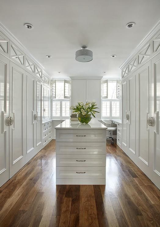 Glamorous Large White Walk In Closet Fitted With A White
