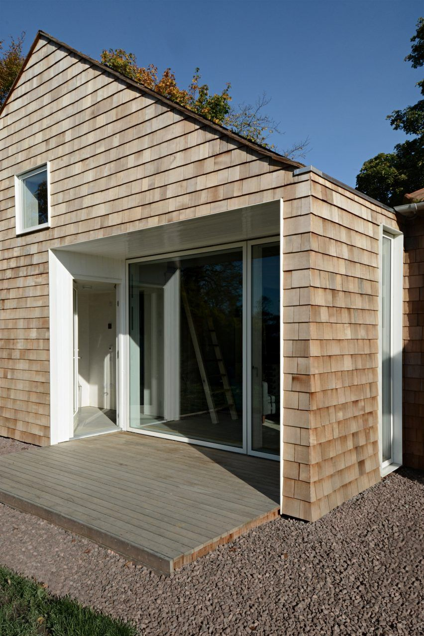 Cedar Wood Shingles Clad The Exterior Walls And Roof Of The Building But A More Pale Palette Was Chosen For The Interi Shingle House Cottage Extension Cottage