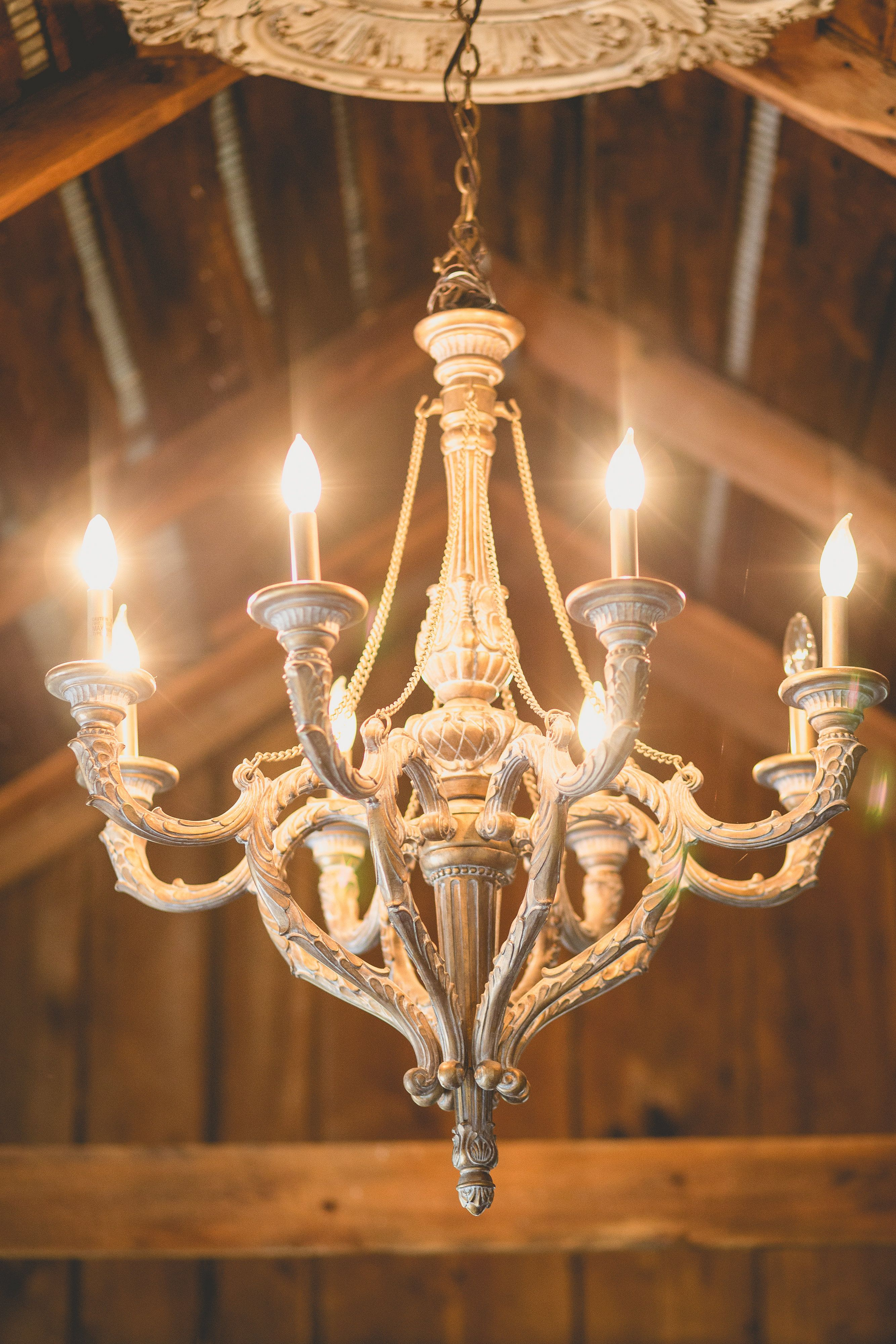 Chandelier in the bridal suite at the milestone barn photo