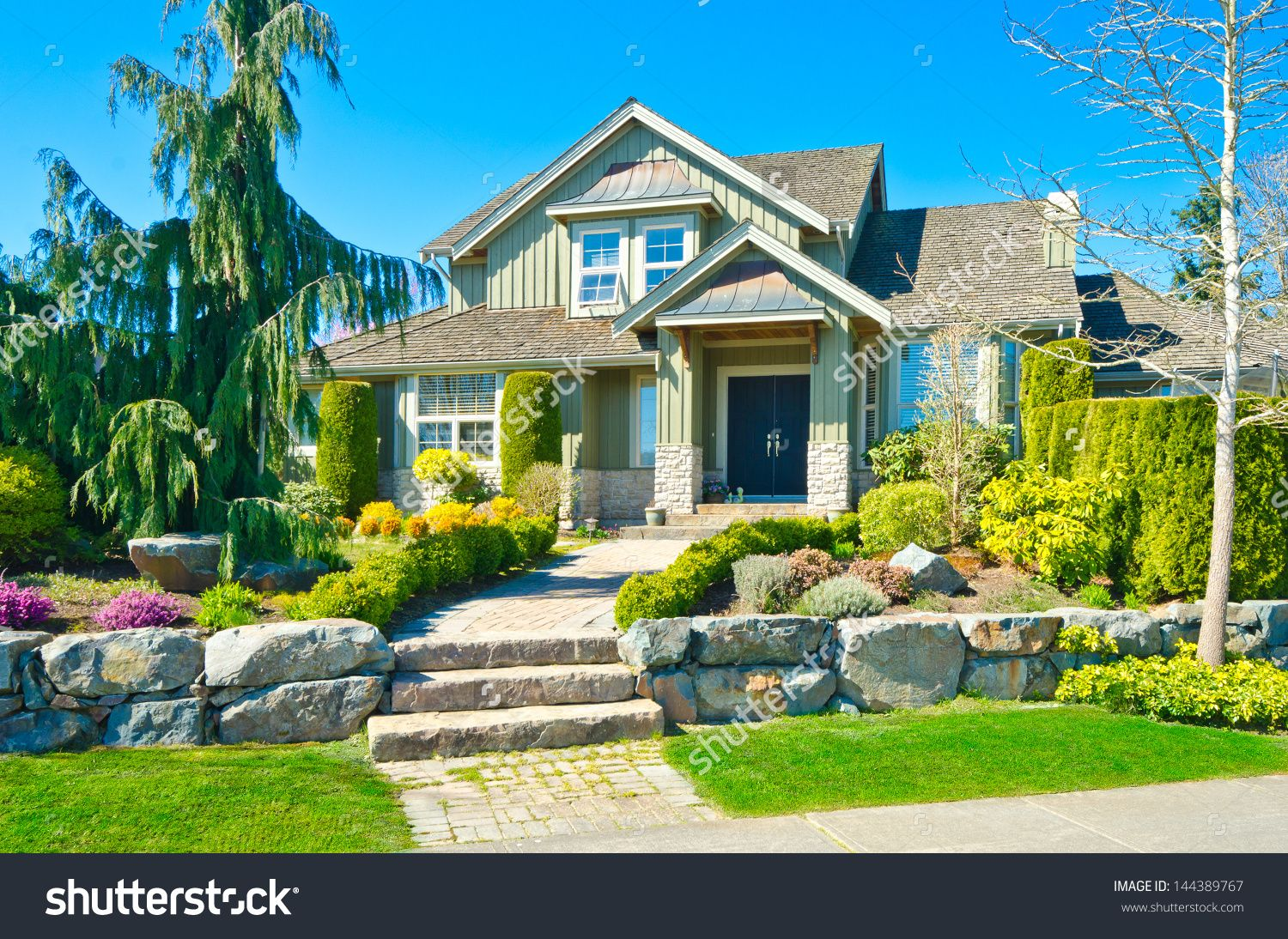 Big custom made luxury house with nicely trimmed and ... on Luxury Front Yard Landscape id=47723