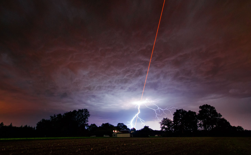On Thursday 18 August, the sky above the Allgäu Public Observatory in southwestern Bavaria was an amazing sight, with the night lit up by two very different phenomena: one an example of advanced technology, and the other of nature's dramatic power.    As ESO tested the new Wendelstein laser guide star unit by shooting a powerful laser beam into the atmosphere, one of the regio...See More — with Rose Aquino, Colette Fletcher, Rosabel Cintron Rosado and Kathy Harris.