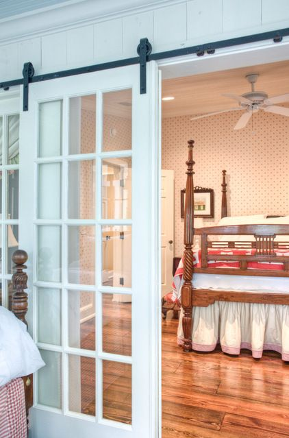 The former master bedroom in the original house now serves - Bedroom with sliding glass doors ...