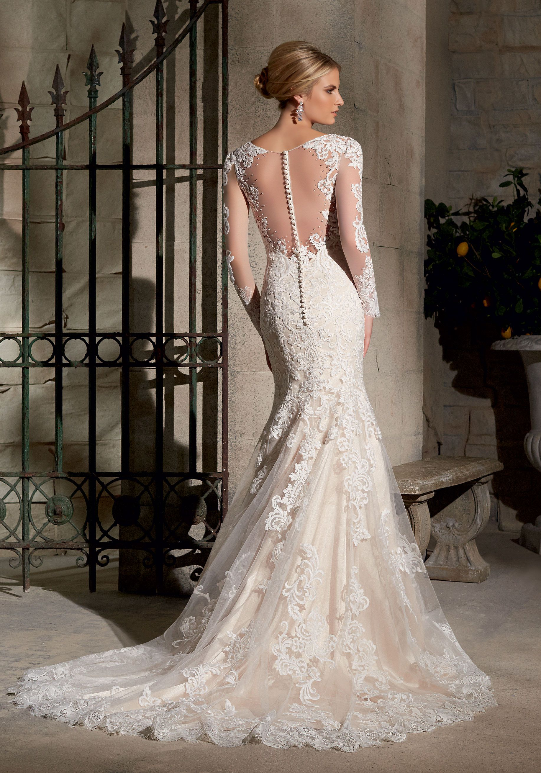 7e8afa80194d This stunning sheath wedding dress features full-length illusion sleeves,  neckline and an illusion open back. Colors available: White, Ivory and Gold.