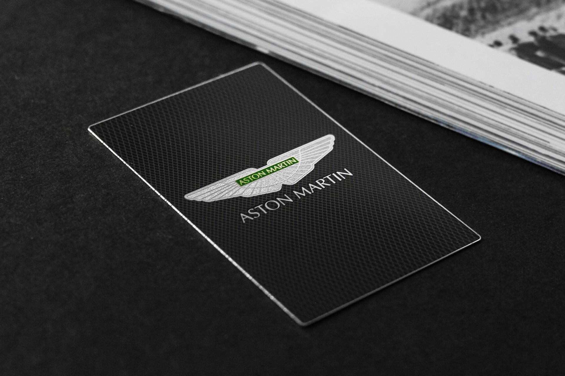 silver metal business card for the british car brand aston martin