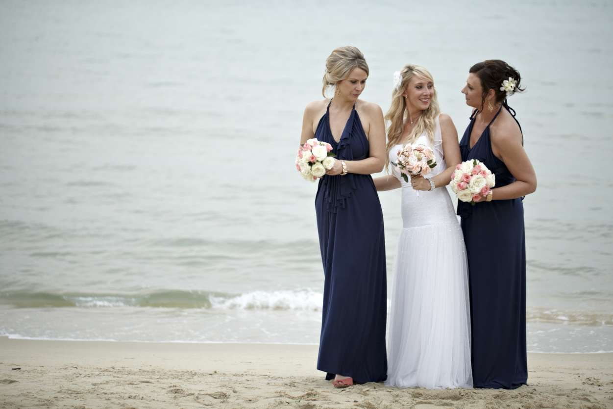 Navy bridesmaid dresses with peach and pink flowers beach weddings wedding navy bridesmaid dresses with peach and pink flowers ombrellifo Gallery