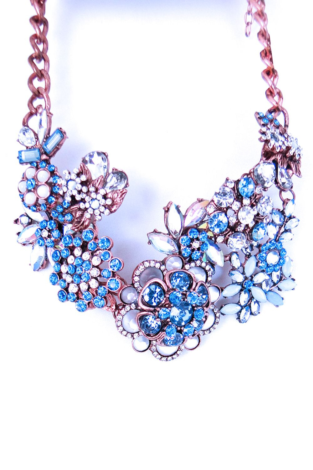 Blue Statements Floral Necklace found on our website and store. Available in pink toooo