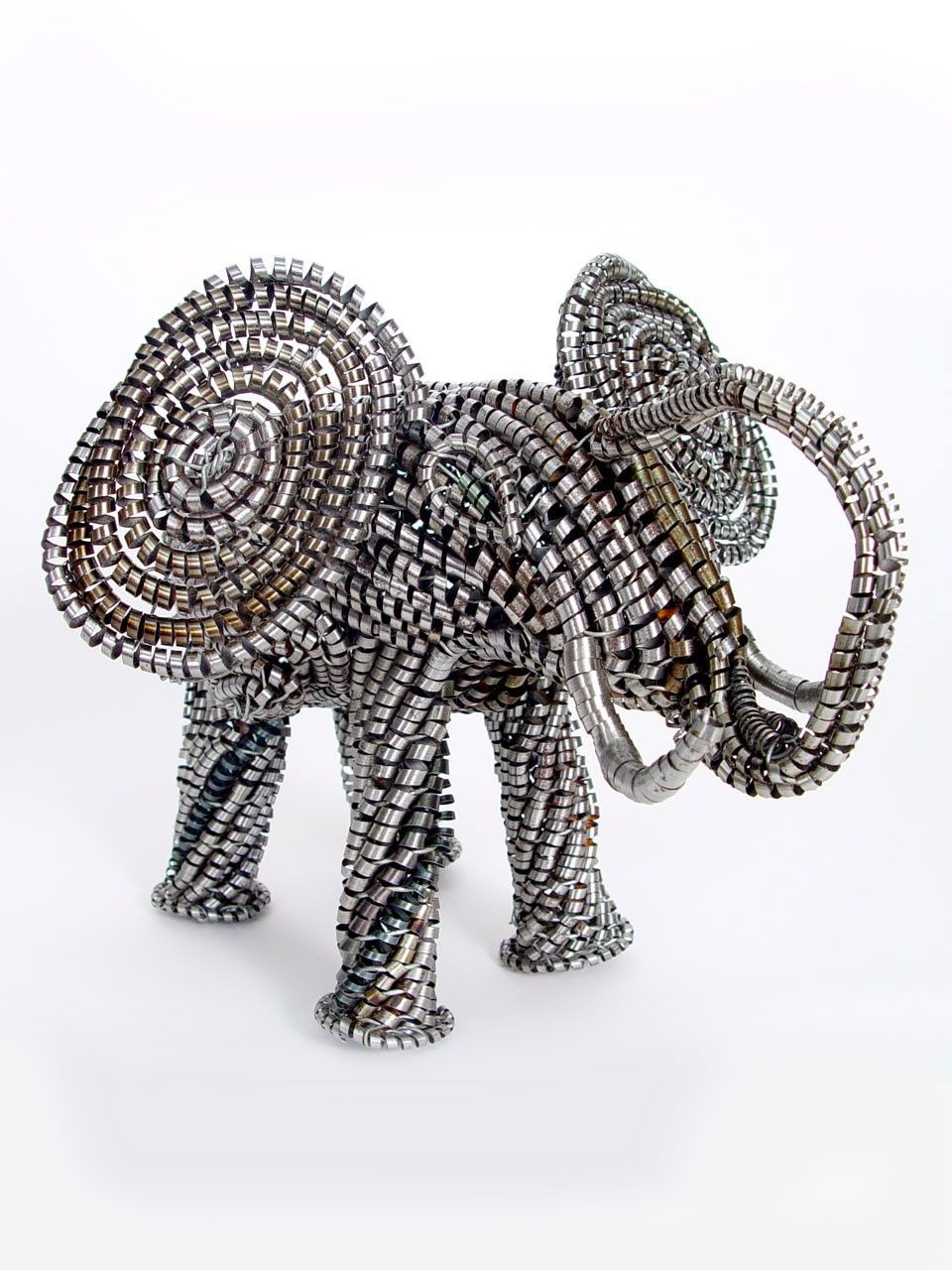 Metal Shaving Elephant - Metal shaving art was invented by former blacksmith Amos Guta in Zimbabwe, and is made almost entirely of recycled materials.  $50.00