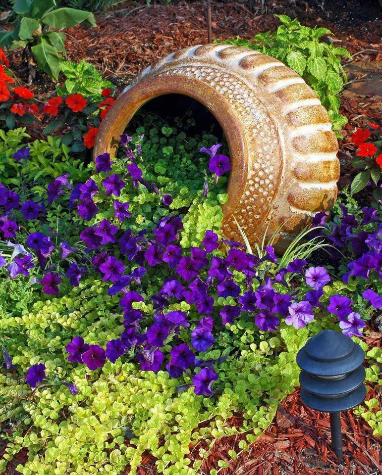 add an overturned plant pot to any flower bed to add a little interest - Outdoor Flower Pots