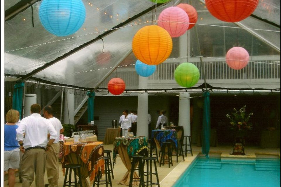 Clear top tent with paper lanterns wedding rentals decor