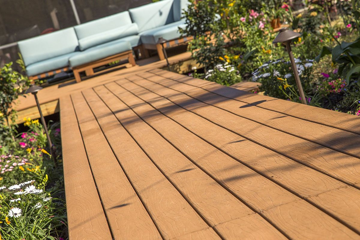 Build a deck as smooth as a hardwood floorcheapest wpc deck composite decking with wood embossed texturing has a better slip resistance than pvc baanklon Images
