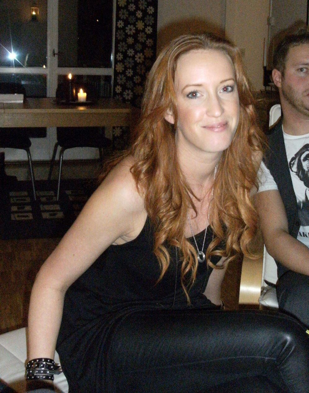 amateur redhead in black leather pants on couch | leather fashion