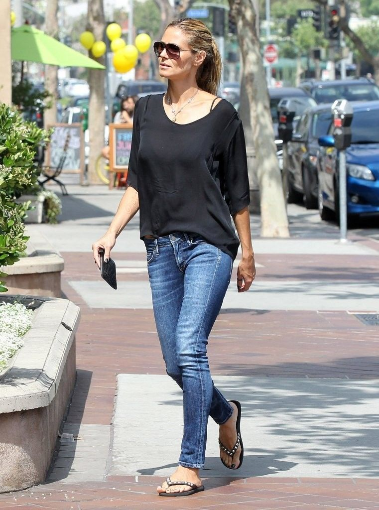 bc4ff60f469f Heidi Klum s Black Blouse and Blue Jeans