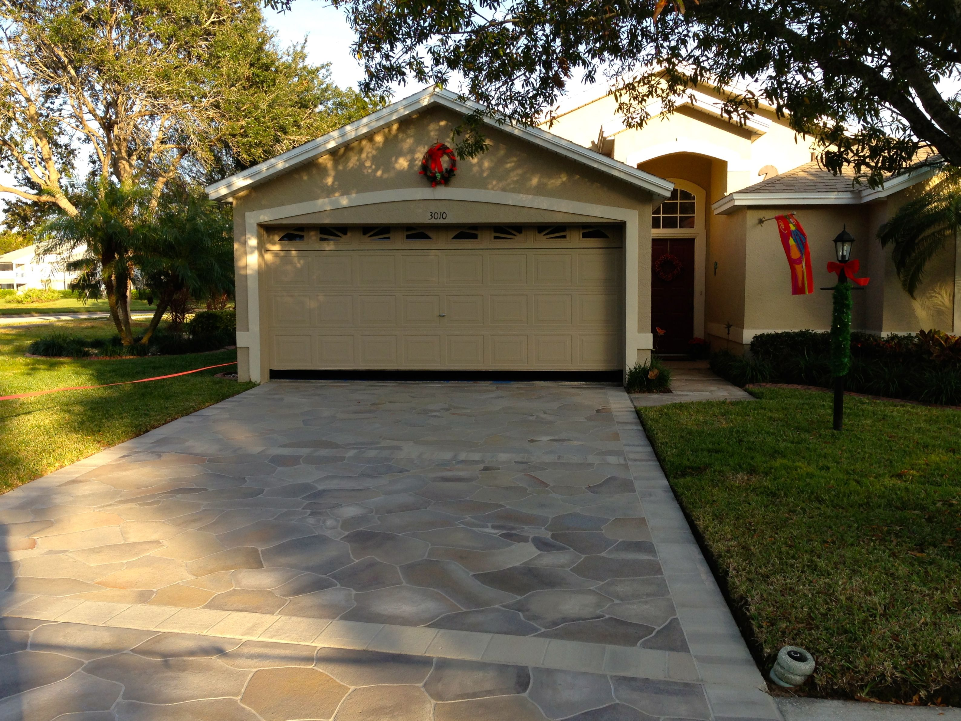 Painted driveways the villages florida concrete designs for Cement driveway ideas