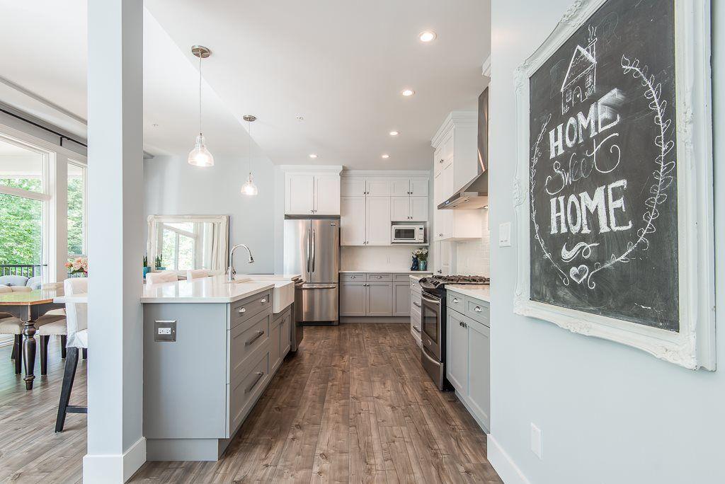 Open galley kitchen with oversized island. #opengalleykitchen