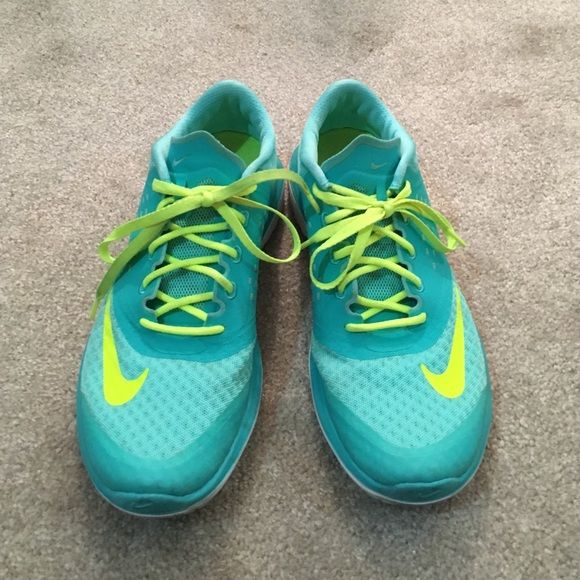 Blue/green nike fitsole They are very lightly used selling because they are too big on me :( Nike Shoes Athletic Shoes